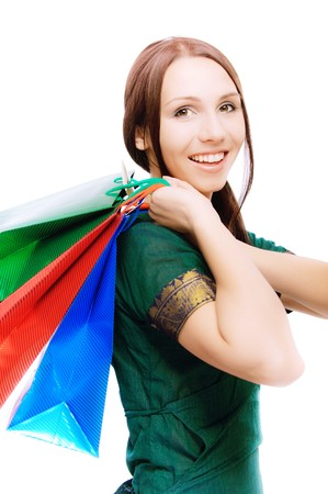 Young beautiful smiling woman with purchases, on white background. Stock Photo - 6977951