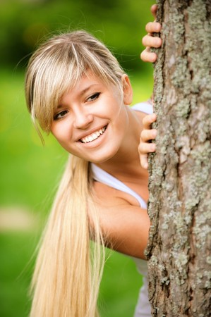 Portrait of smiling young woman close up on green background. photo