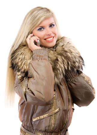 conversa: Sonrisas de rubias encantadoras y las conversaciones sobre la telefon�a celular. Foto de archivo