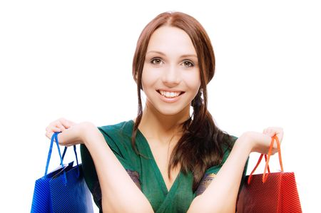 Young beautiful smiling woman with purchases, on white background. Stock Photo - 7049102