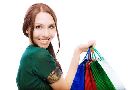 Young beautiful smiling woman with purchases, on white background. Stock Photo - 7086052