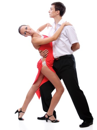 Young couple dances tango, on white background.