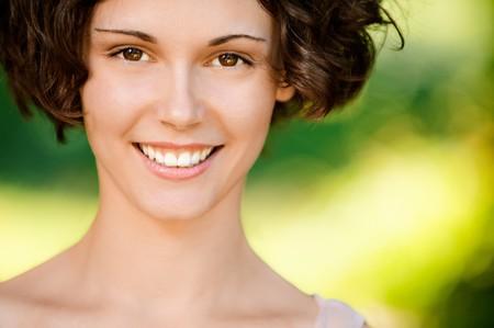 Portrait of lovely smiling girl, on green background. Stock Photo - 7517086