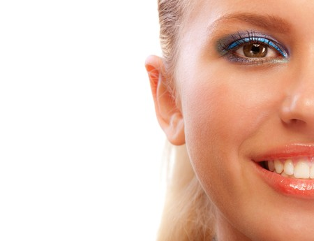 blonde close up: Half face of smiling blonde close up, isolated on white background. Stock Photo