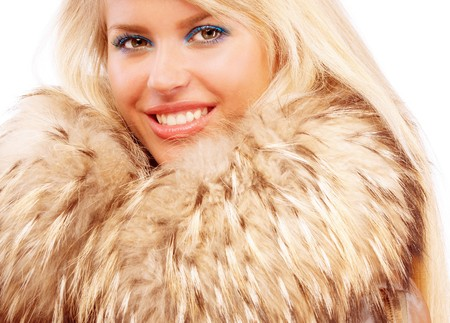 Portrait of smiling fair-haired woman in fur coat photo