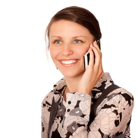 Business girl speaks on cellular telephone, it is isolated on white background. Stock Photo - 7599956