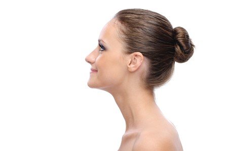 Portrait of profile charming woman with bared shoulders, on white background. Stock Photo - 7599925