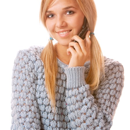 Girl talking on her cell phone and smiling, isolated on white background. Stock Photo - 7635916