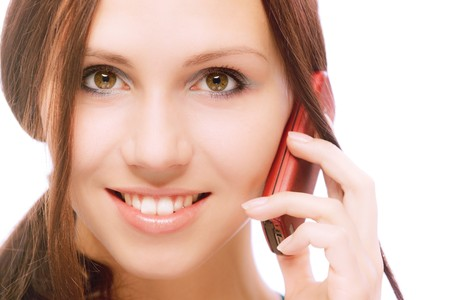 Charming girl speaks by phone, on white background. photo
