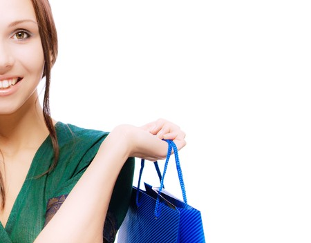 Half face young beautiful smiling woman with purchases, on white background. Stock Photo - 7657465