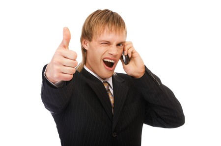 tumb: portrait of young blond man in suit speaking on phone and showing tumb up on white Stock Photo