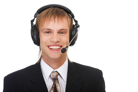 portrait of young blond man in suit and headset on white photo