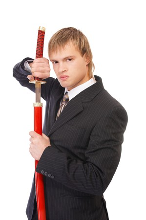 portrait of youn blond man in black suit with katana sword on white photo