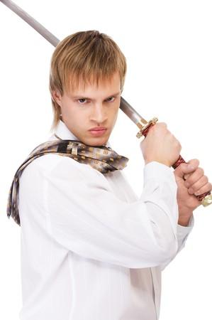 portrait of businessman in white shirt raising katana sword photo