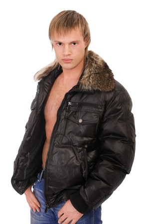 bare chest: portrait of young blond man in leather jacket on bare torso with furry collar on white