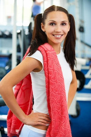 portrait of sporty girl with red towel in gym Stock Photo - 7658136