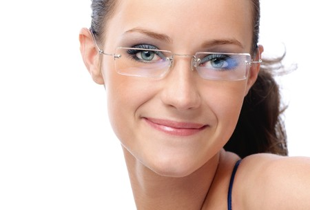 Beautiful young smiling woman in glasses, on white background. photo