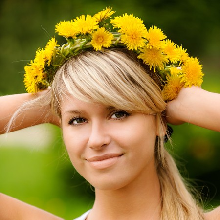 Young woman in wreath from yellow dandelions. Stock Photo - 7657730
