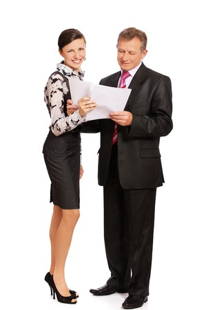 secretary bringing papers to senior handsome businessman photo