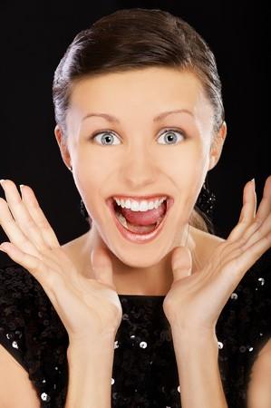 closeup portrait of happy brunette girl shouting photo