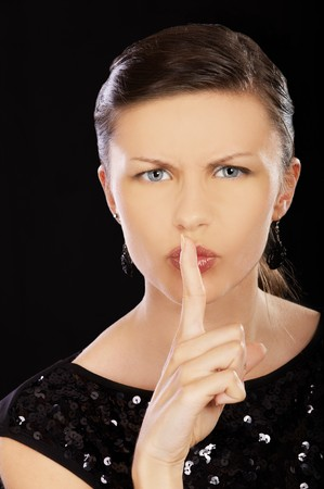 portrait of brunette girl asking to keep quiet photo
