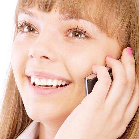 Businesswoman on phone, isolated on white background. Stock Photo - 7811270
