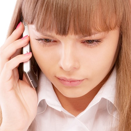 Businessgirl is dissatisfied with phone conversation, isolated on white background. Stock Photo - 7811111