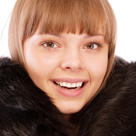 Portrait of beautiful woman wearing fur coat, isolated on white background. photo
