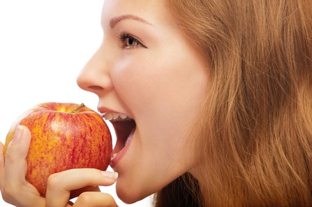 portrait of beautiful blonde with red apple on white Stock Photo - 7811305