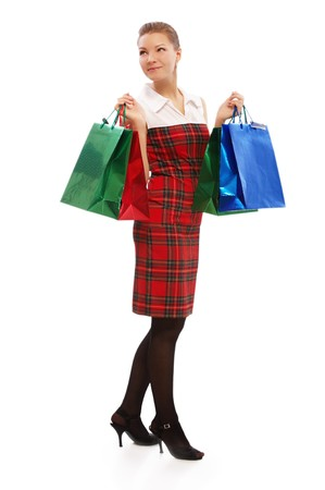full-length portrait of beautiful blonde girl in checked dress with shopping bags on white photo