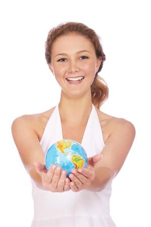portrait of smiling girl posing with globe photo