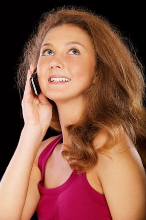 portrait of happy girl with cellphone on black Stock Photo - 7874499