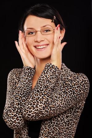 portrait of beautiful brunette in glasses on black photo
