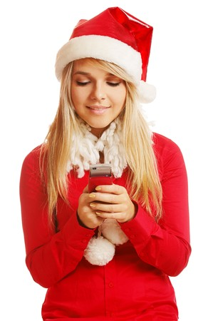 portrait of beautiful blonde girl in xmas clothes with cellphone on white photo