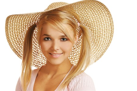 portrait of beautiful blonde girl in straw hat on white photo