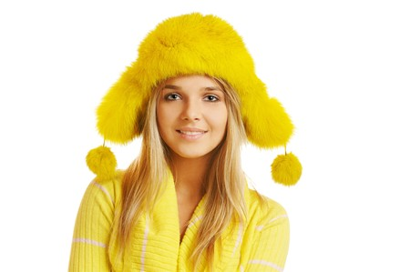 pompon: portrait of beautiful blonde girl in yellow furry cap with ear flaps