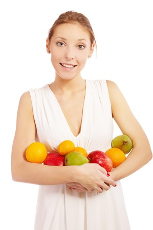 portrait of beautiful girl in white dress with assorted fruits on white photo