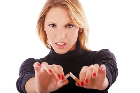 portrait of blonde girl broking cigarette on white photo