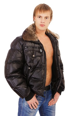 portrait of young blond man in leather jacket on bare torso with furry collar on white photo