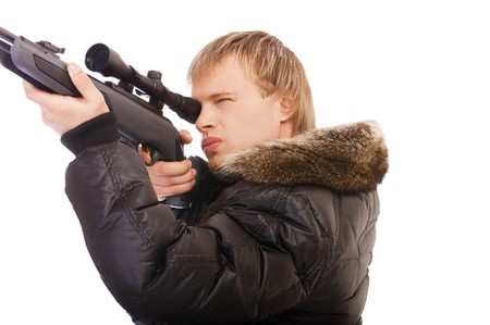 portrait of blonde man with scoped rifle aiming photo