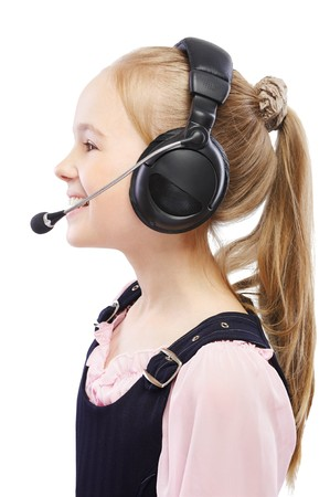 portrait of blonde child girl in headset on white