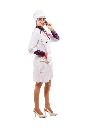 phonecall: full-length portrait of happy female doctor making phonecall on white Stock Photo