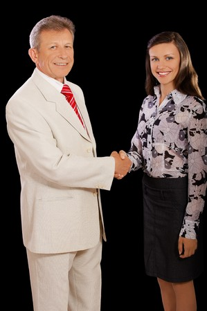 portrait of senior businessman and young woman secretary shaking hands on black  photo