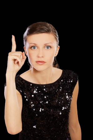 concept portrait of brunette girl having an idea and pointing index finger up photo