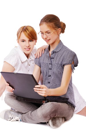 expression portrait of two happy young women with laptop sitting on white Stock Photo - 8016457