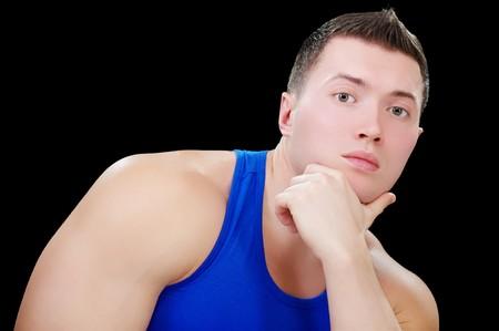 estimating: portrait of muscular athlete man looking estimating on black