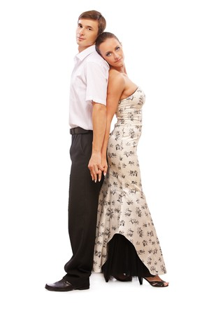 isolated portrait of gorgeous girl and man dancers standing back to back photo