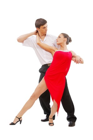 tango dance: isolated portrait of gorgeous girl and man performing salsa