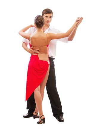 isolated portrait of gorgeous girl and man performing salsa. girl is standing back to camera photo