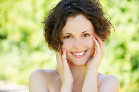 clean skin: outside close-up portrait of beautiful young happy woman with fresh and clean skin